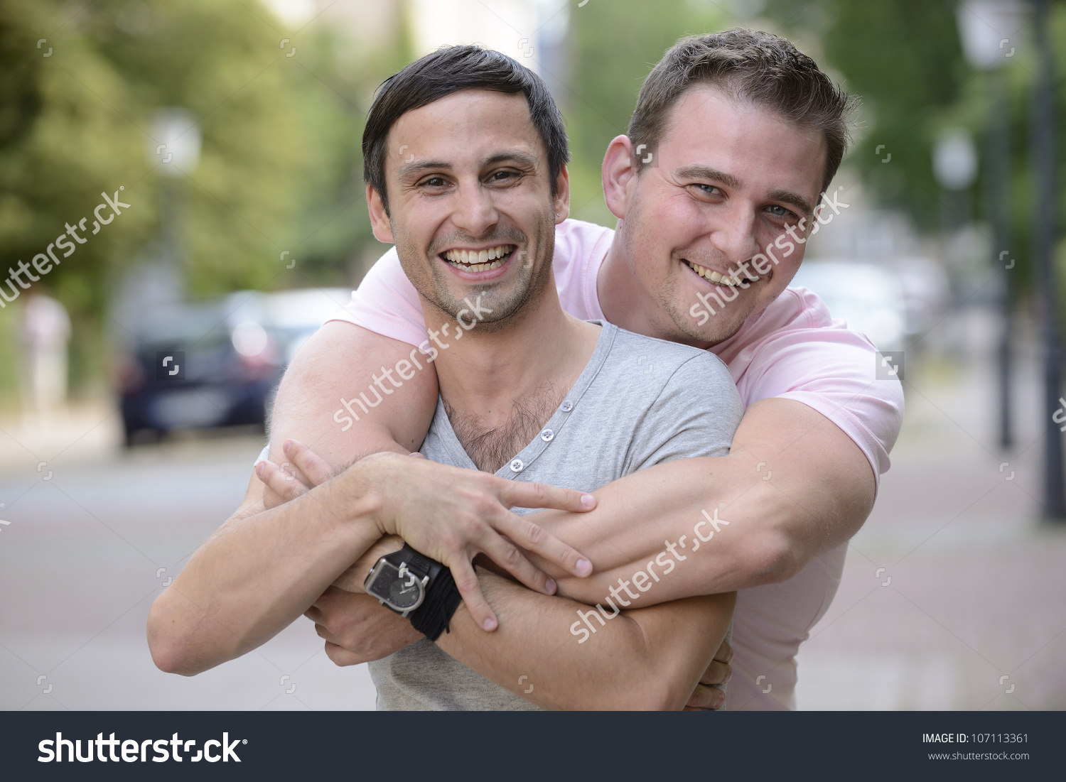 stock-photo-portrait-of-a-happy-gay-couple-outdoors-107113361